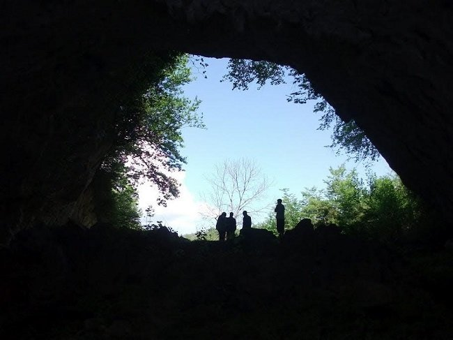 The entrance to the Satsurblia Cave in Georgia where the remains was discovered.  Image via Daniel Bradley/TCD