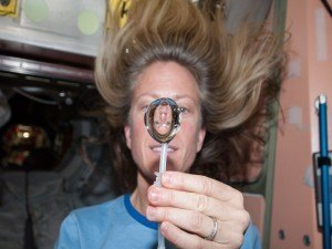 NASA astronaut recruitment: NASA astronaut Karen Nyberg, squeezes a water bubble out of her beverage container, showing her image refracted