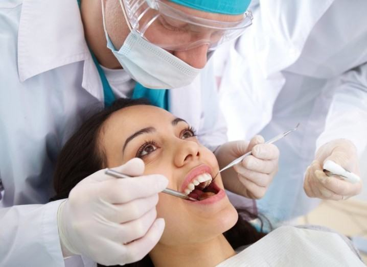 Dental: dentist works on patient