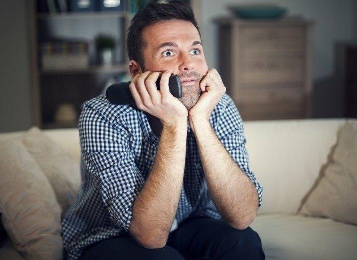 Binge-watch: man gazing lovingly at TV