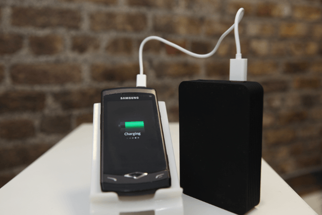 Juice Power Station charging phone