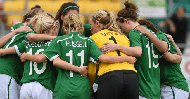 Irish women's football team huddles up
