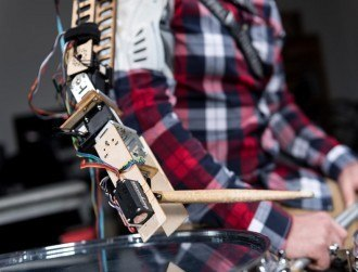 Watch: A wearable robot arm lets you be a 3-armed drummer