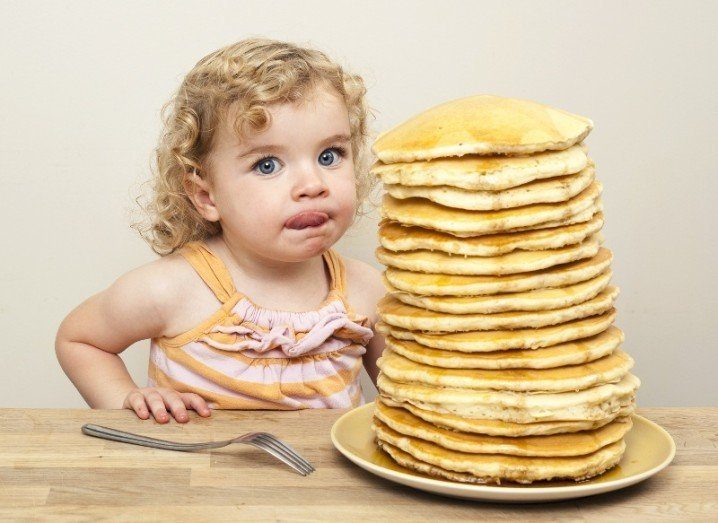 Pancake Tuesday: girl with stack of pancakes