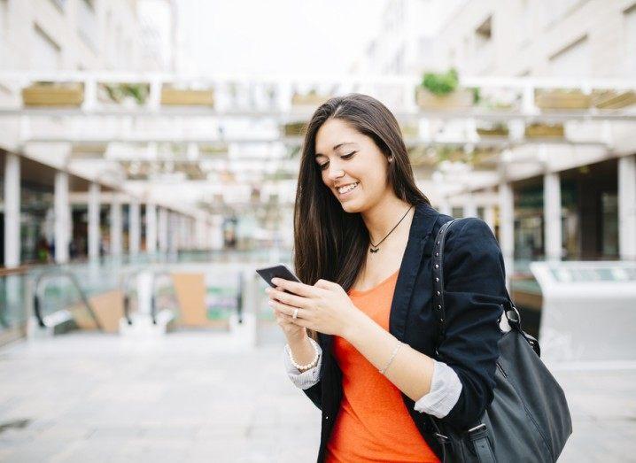 Three introducing ad blocking: woman using phone