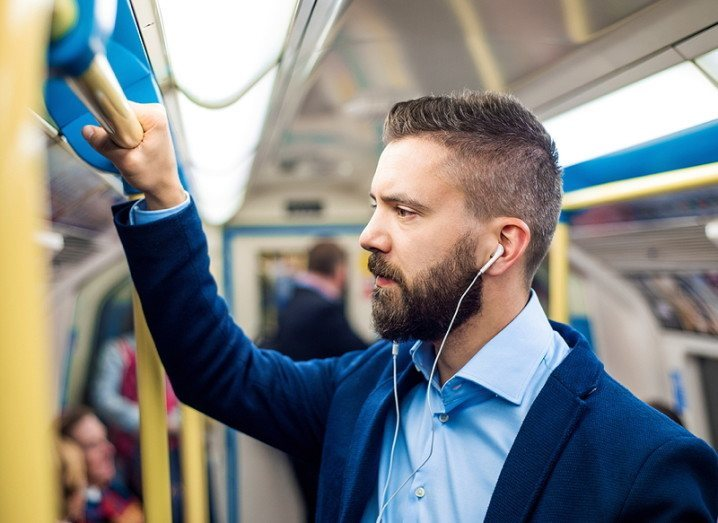 Commuting: commuter listening to music