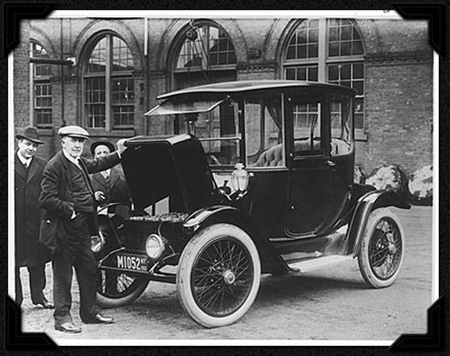 Thomas Edison pictured with an electric car