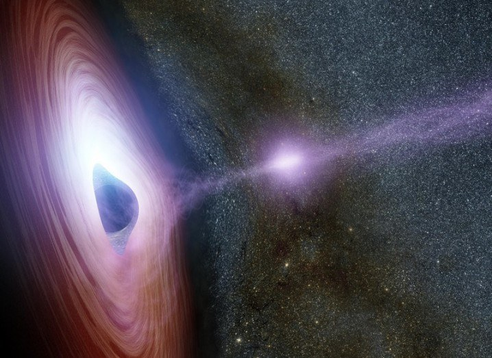 Artist's concept of a supermassive black hole, surrounded by a swirling disk of material falling onto it. The purplish ball of light depicted launching from the black hole is its corona. The launch of the corona may generate an X-ray flare, via NASA/JPL-Caltech.