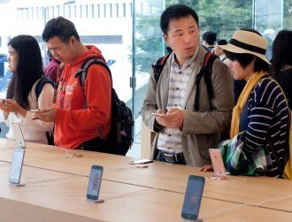 In China, there are now two iPhones, and one isn't Apple's