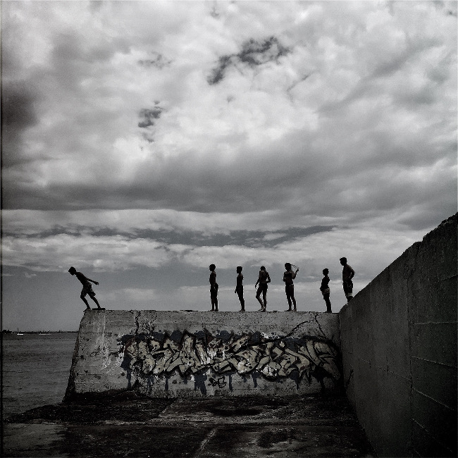 "Kevin Casey won first place in the Others category – ""This was taken at Botany Bay, Sydney, Australia and is one of my favourite spots during summer. I have taken literally hundreds of shots of the local kids lining up and jumping, diving and doing backflips off this wall."" IPPAWARDS iPhone"