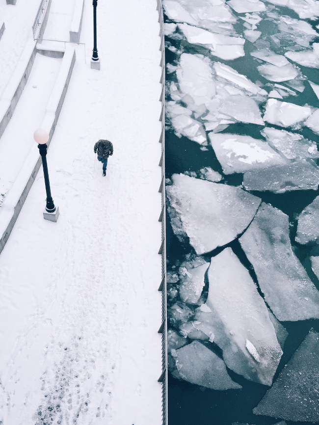 "Cocu Liu took second spot – ""This photo was taken in Chicago on an extreme cold day. I was looking down to the frozen river with ice floes from the bridge above, what I like about the scene was the geometric shapes and compositional contrast from the high perspective."""