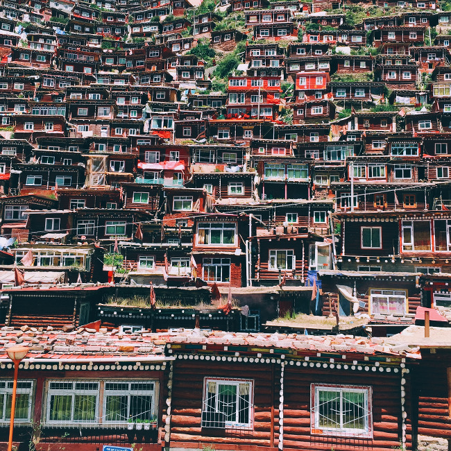 "Shiyang Han took third place in Travel – ""This photo was taken at Seda Larong Wuming Buddhist Institute, Sichuan, China. It's the largest buddhist institute in the world."""