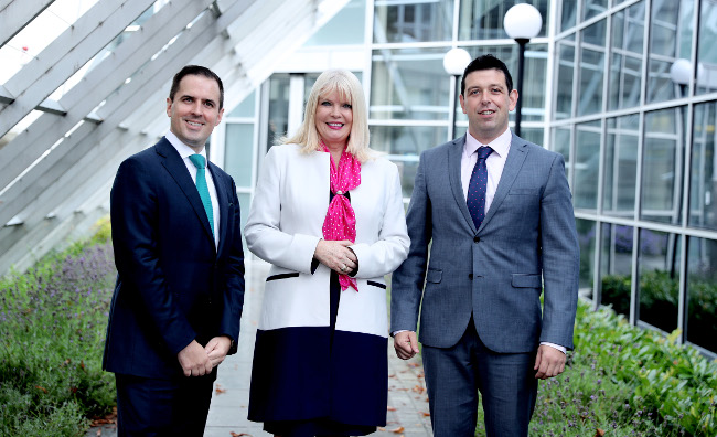 Minister for Jobs Mary Mitchell O'Connor with (left) Martin Shanahan, CEO of IDA Ireland and (right) Derek Delaney, MD of DMS Europe
