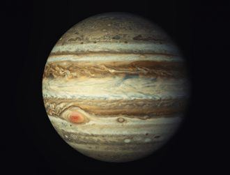Jupiter's red, giant superstorm source of planet's heat