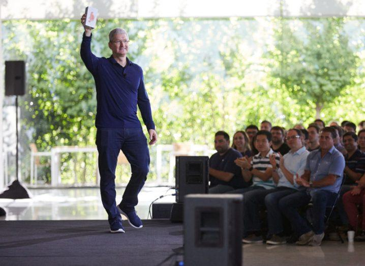 Tim Cook holds one-billionth iPhone sold
