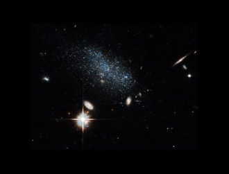 Hubble finds two dwarf galaxies heading for the 'big city'