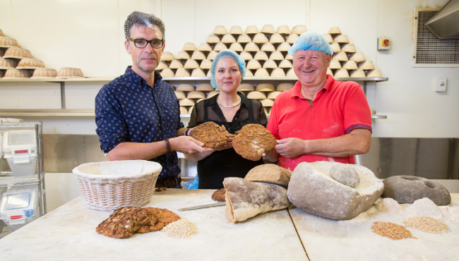 UCC archaeology lecturers Dr Ben Gearey and Dr Katharina Becker with Declan Ryan of Arbutus Bread. Image via Tomás Tyner, UCC