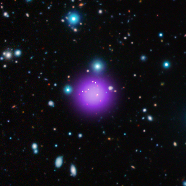 Galaxy Cluster CL J1001 is the most distant of its kind ever recorded. Image via NASA/CXC/CEA/T. Wang et al (X-ray); ESO/UltraVISTA (Infrared); ESO/NAOJ/NRAO/ALMA (Radio)