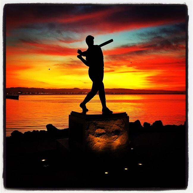 Willie McCovey statue on Opening Day in San Francisco, 2016. Image via Brad Mangin