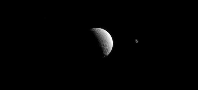 Saturn's moons Tethys and Hyperion. Image via NASA/JPL-Caltech/Space Science Institute