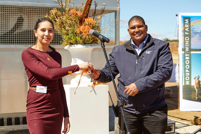 Mainstrean's Aniqah Misbach with Denis Solomon, plant manager of the new facility - wind farm