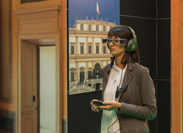 Woman wearing glasses for augmented reality at Smau, international exhibition of information communications technology. Image: Tinxi/Shutterstock
