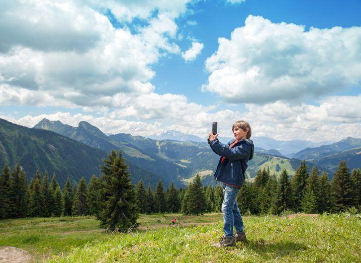 Citizen scientist boy in nature