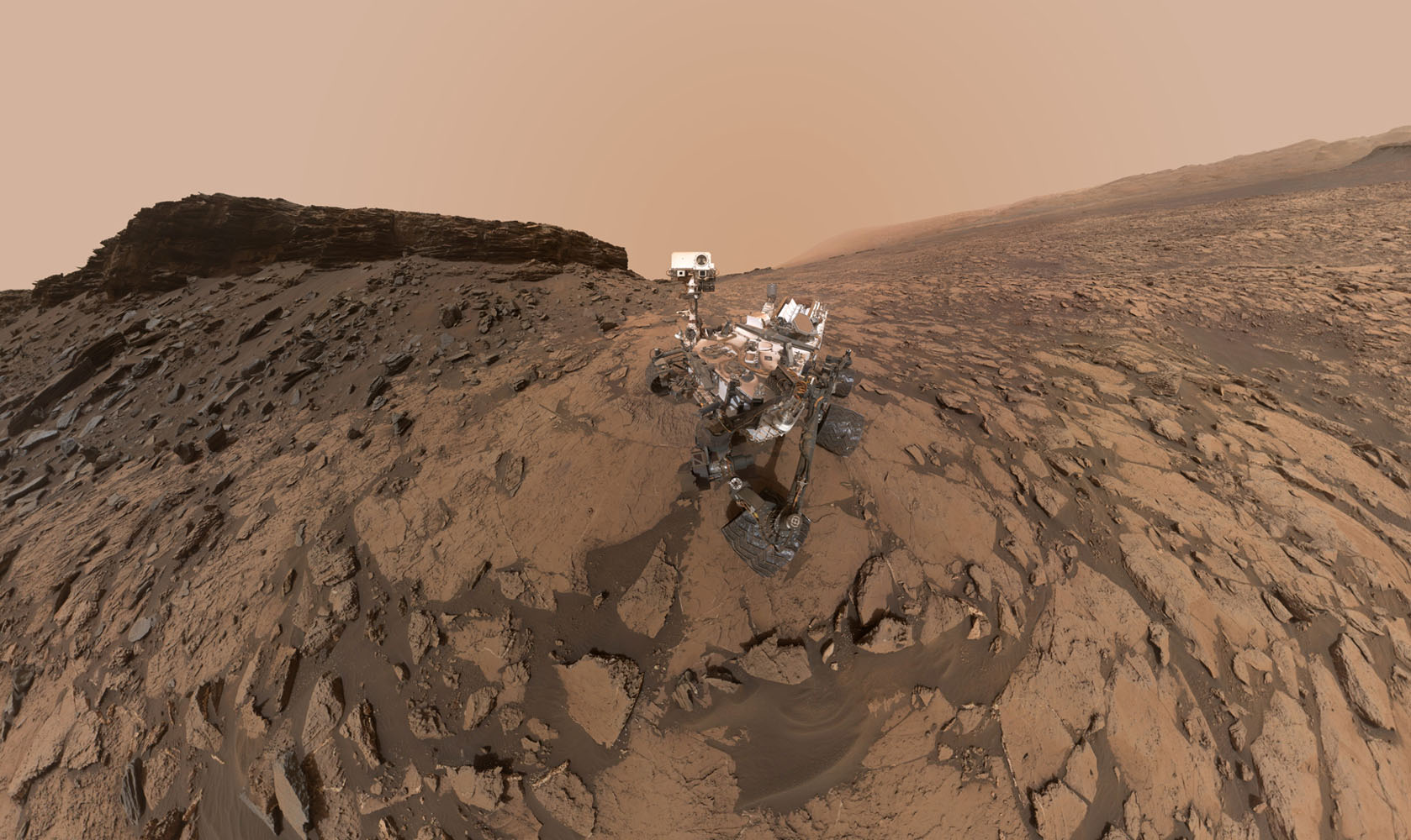 Curiosity Mars rover at Mount Sharp (click to emlarge). Image: NASA/JPL-Caltech/MSSS