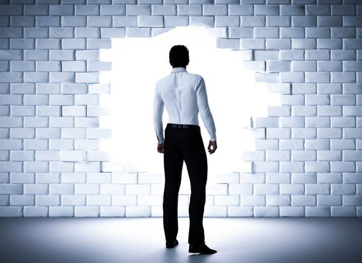 Man breaks down wall