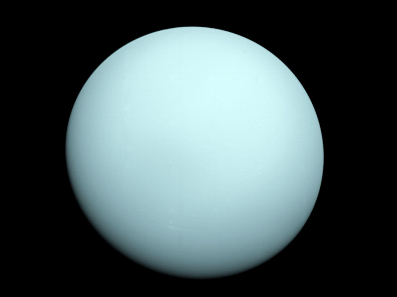 Arriving at Uranus in 1986, Voyager 2 observed a bluish orb with extremely subtle features. A haze layer hid most of the planet's cloud features from view. Image: NASA/JPL-Caltech