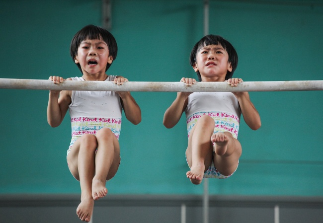 This series was taken in a sports school in Jining, in Shandong province, China. Liu Bingqing and Liu Yujie are twin sisters, who have liked gymnastics since their childhood. They have studied, trained and grown up here. Image: Yuan Peng, China, Shortlist , Professional, Sport, 2017 Sony World Photography Awards