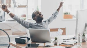 Man feeling happy with his career goals