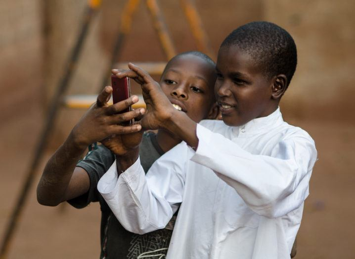 Children using smartphone