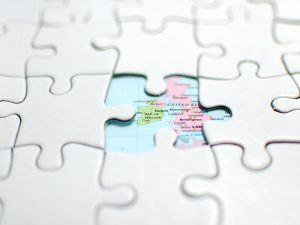 Map of Ireland surrounded by a jigsaw puzzle