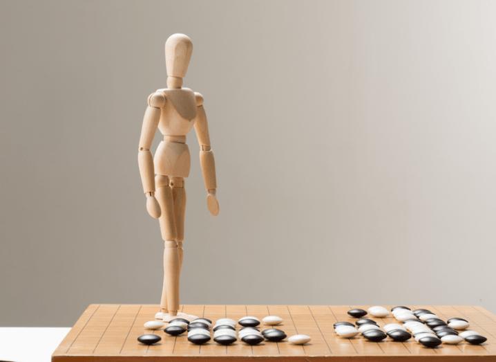Go board and figurine