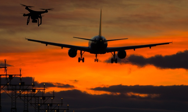 Drone with plane | Air traffic control. Image: Dmitry Kalinovsky/Shutterstock