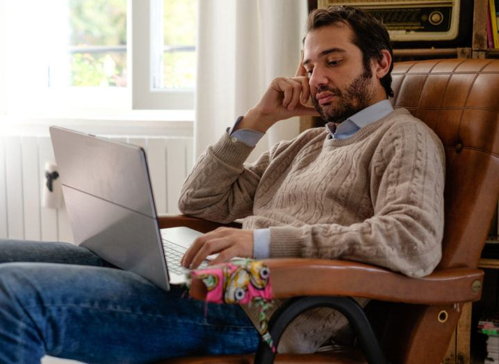 Man in chair on a laptop