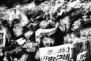 """Student Protesters March. """"Among the most vocal and energetic groups taking part in the anti-president demonstrations are young South Korean students."""" Image: Argus Paul Estabrook. Street Series Winner, Magnum and LensCulture Photography Awards 2017."""