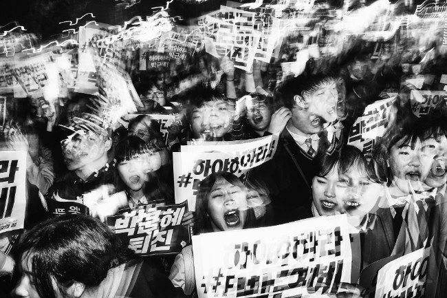 "Student Protesters March. ""Among the most vocal and energetic groups taking part in the anti-president demonstrations are young South Korean students."" Image: Argus Paul Estabrook. Street Series Winner, Magnum and LensCulture Photography Awards 2017."