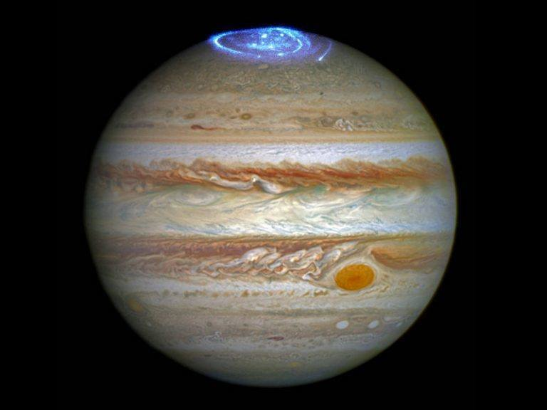 Astronomers are using NASA's Hubble Space Telescope to study auroras on the poles of the largest planet in the solar system, Jupiter, via NASA, ESA, and J. Nichols