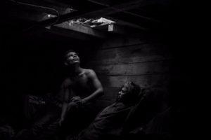 Bangladeshi and Pakistani migrants wait to be evacuated. Image: Jason Florio. Photojournalism Series Winner, Magnum and LensCulture Photography Awards 2017.