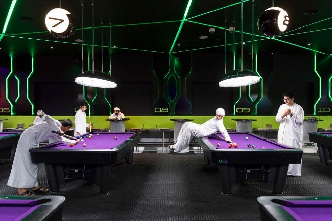 Hub Zero, Dubai, January 2017. Emirati boys playing a game of pool at Hub Zero, an immersive entertainment hub located at City Walk shopping mall. Image: Nick Hannes, Documentary Series Winner, Magnum and LensCulture Photography Awards 2017.