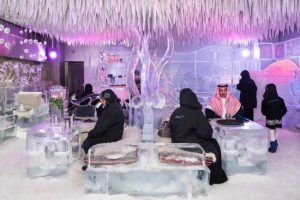 Chillout Ice Lounge, Dubai, January 2016. Saudi tourists having a hot chocolate at the Chillout Ice Lounge, the first ice lounge in the Middle East, with ice sculptures, ice seating and tables, all at a subzero temperature. Image: Nick Hannes, Documentary Series Winner, Magnum and LensCulture Photography Awards 2017.