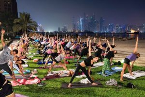 Full moon yoga session, Dubai, September 2016. Full moon yoga session at Fairmont The Palm Hotel and Resort in Dubai. Image: Nick Hannes, Documentary Series Winner, Magnum and LensCulture Photography Awards 2017.