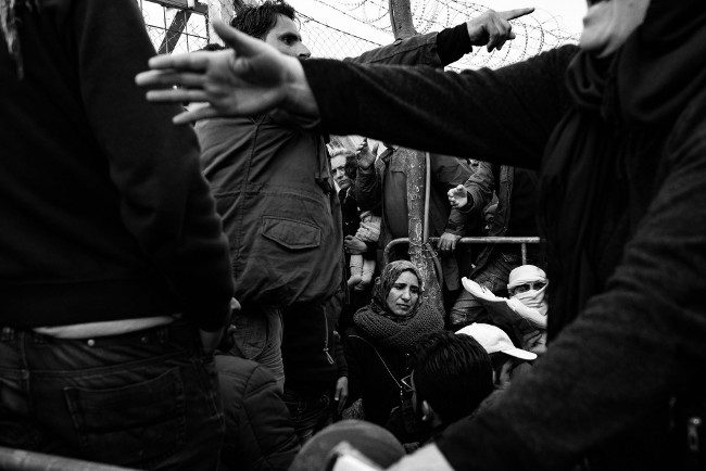 "'Fleeing Death.' ""Refugees in the queue for the checkpoint at Idomeni, Greece. March 6, 2016"". ImageL Szymon Barylski. Photojournalism Single Image Winner, Magnum and LensCulture Photography Awards 2017."