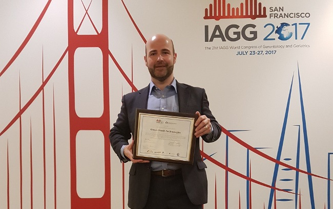 Seamus Small, CEO of Kinesis Health Technology, with his company's IAGG award.