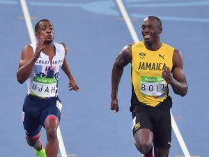 Could Usain Bolt (right) out-run a T-rex? Image: Shahjehan/Shutterstock
