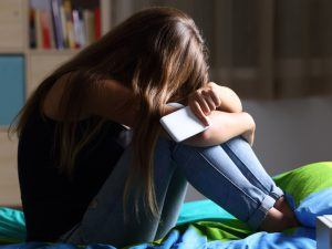 Depressed girl with mobile