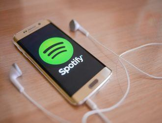 Spotify inches closer to going public after inking Warner Music deal