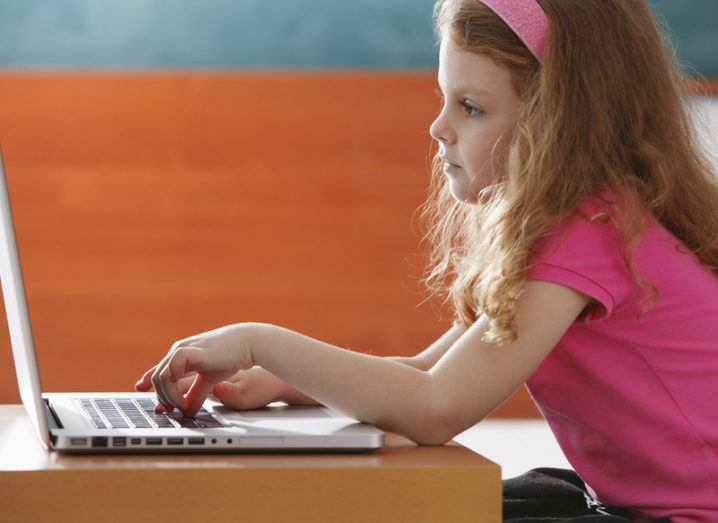 young girl on computer